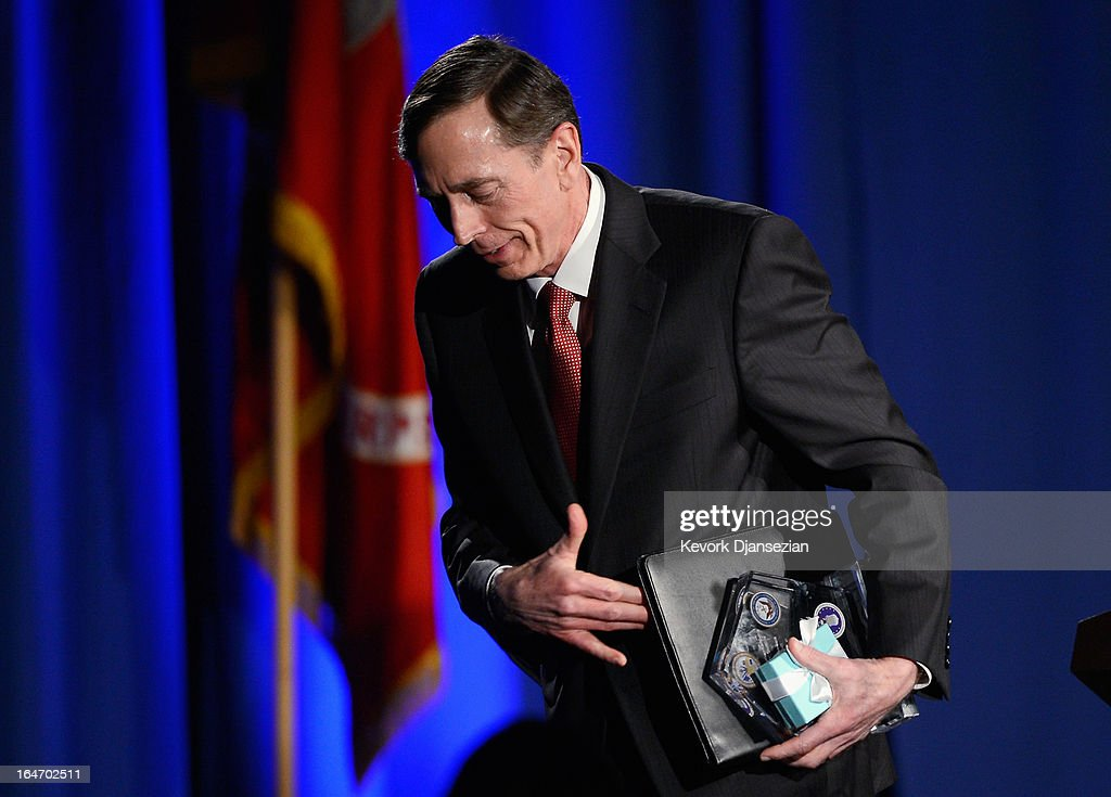Former CIA director and retired four-star general David Petraeus (L) leaves the podium after making his first public speech since resigning as CIA director at University of Southern California dinner for students Veterans and ROTC students on March 26, 2013 in Los Angeles, California. Petraeus apologized in his speech for his actions that lead to him resigning from the CIA.