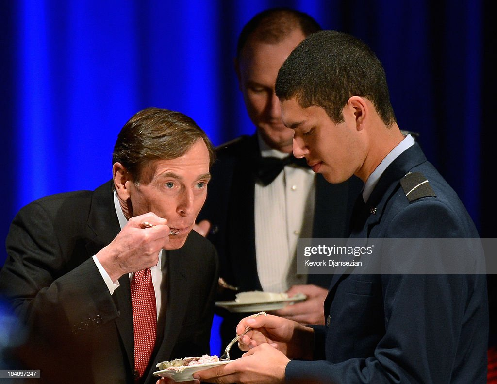 Former CIA director and retired four-star general General David Petraeus (L) shares a portion of a cake with armed sevices ROTC Hector Sandoval (R) before making his first public speech since resigning as CIA director at University of Southern California dinner for students Veterans and ROTC students on March 26, 2013 in Los Angeles, California. Petraeus is expected to apologize in his speech for the extramarital affair that ended his career.