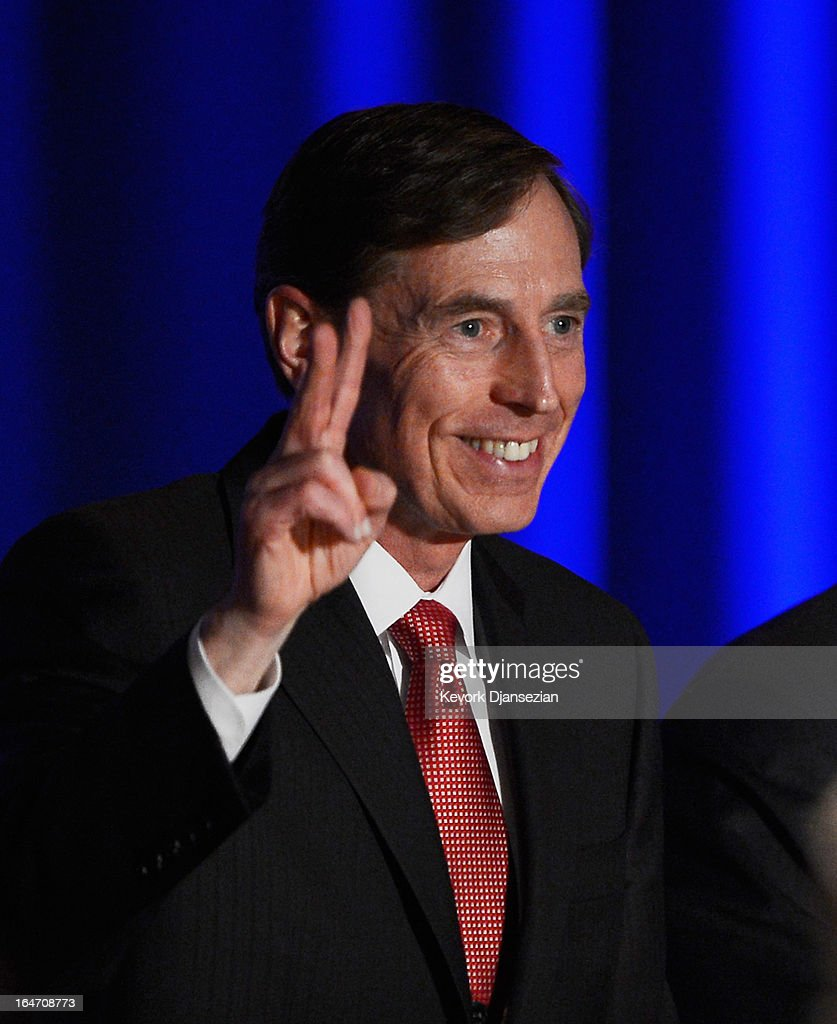 Former CIA director and retired four-star general General <a gi-track='captionPersonalityLinkClicked' href=/galleries/search?phrase=David+Petraeus&family=editorial&specificpeople=175826 ng-click='$event.stopPropagation()'>David Petraeus</a> applauds as he makes his first public speech since resigning as CIA director at University of Southern California dinner for students Veterans and ROTC students on March 26, 2013 in Los Angeles, California. Petraeus apologized in his speech for his actions that lead to him resigning from the CIA.