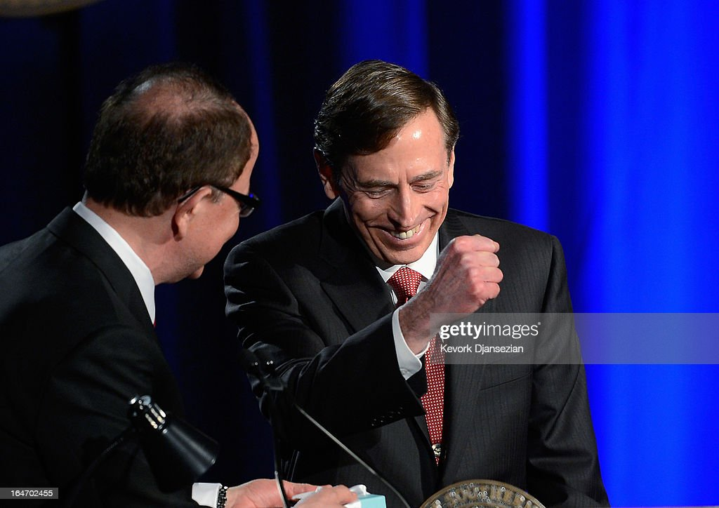 Former CIA director and retired four-star general General <a gi-track='captionPersonalityLinkClicked' href=/galleries/search?phrase=David+Petraeus&family=editorial&specificpeople=175826 ng-click='$event.stopPropagation()'>David Petraeus</a> (R) makes his first public speech since resigning as CIA director at University of Southern California dinner for students Veterans and ROTC students on March 26, 2013 in Los Angeles, California. Petraeus apologized in his speech for his actions that lead to him resigning from the CIA.