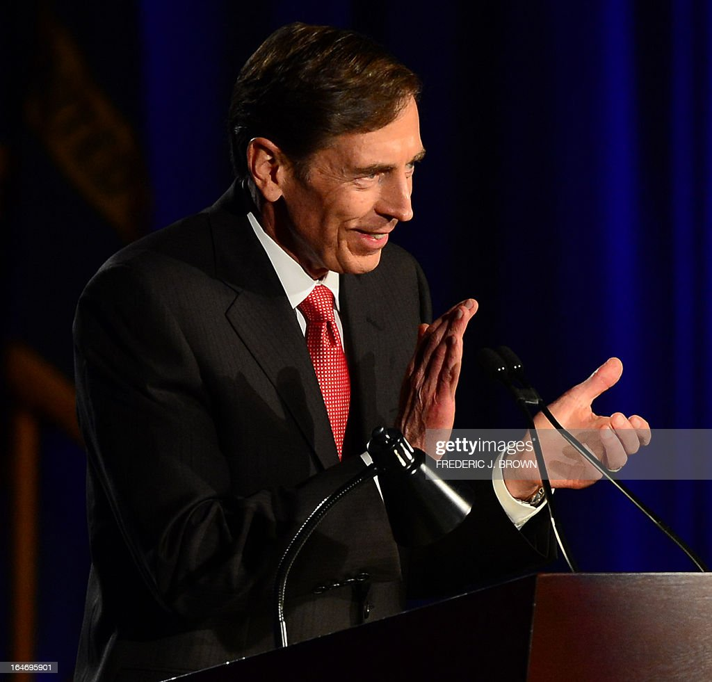 Former CIA director David Petraeus applauds prior to speaking at a University of Southern California event honoring the military on March 26, 2013 in Los Angeles, California. In the first public appearance since stepping down last November as head of the CIA after admitting to an affair, Petraeus said he regretted and apologized for the circumstances that led to his resignation. AFP PHOTO / Frederic J. BROWN