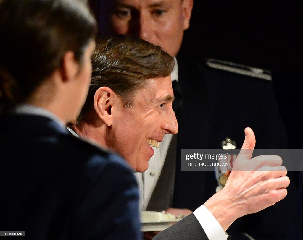 Former CIA director David Petraeus gives the thumbs up after cutting a cake prior to speaking at a University of Southern California event honoring the military on March 26, 2013 in Los Angeles, California. In the first public appearance since stepping down last November as head of the CIA after admitting to an affair, Petraeus said he regretted and apologized for the circumstances that led to his resignation. AFP PHOTO / Frederic J. BROWN
