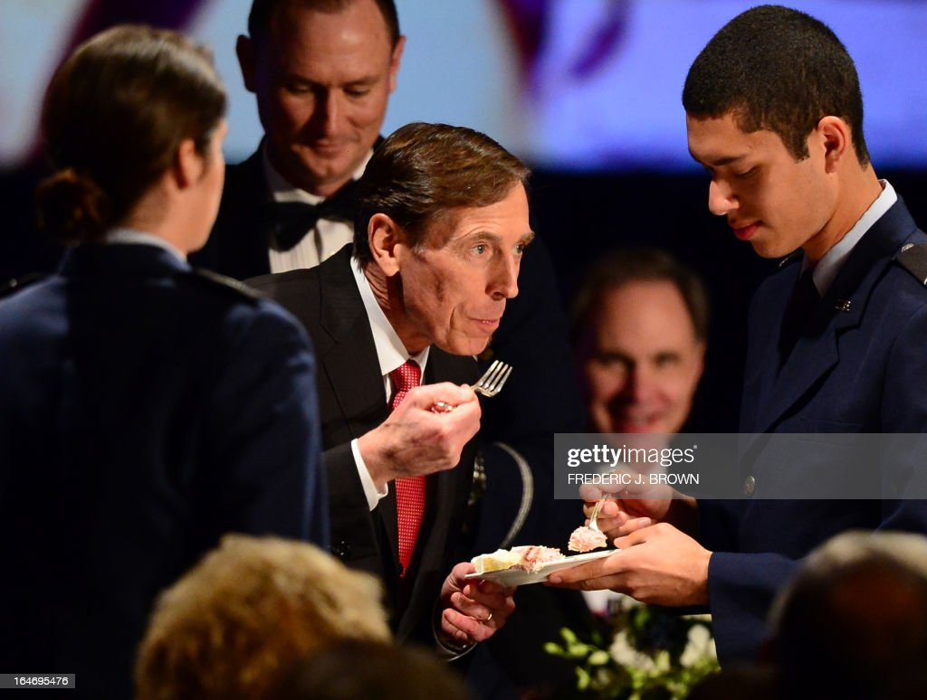 Former CIA director David Petraeus has a piece of the cake he cut prior to speaking at a University of Southern California event honoring the military on March 26, 2013 in Los Angeles, California. In the first public appearance since stepping down last November as head of the CIA after admitting to an affair, Petraeus said he regretted and apologized for the circumstances that led to his resignation. AFP PHOTO / Frederic J. BROWN