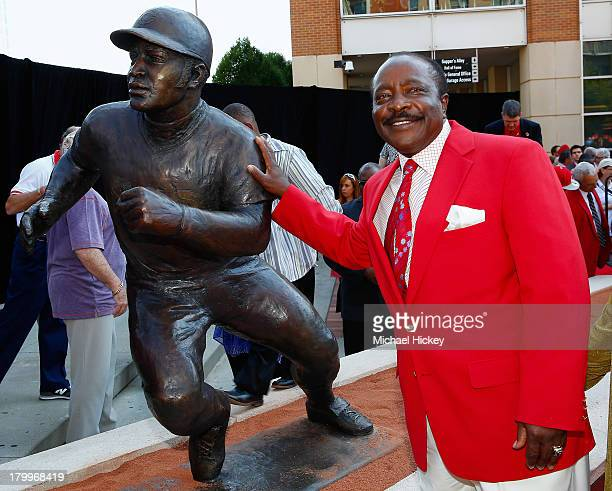 Former Cincinnati Reds and Hall of Fame player Joe Morgan poses with his sculpture that was unveiled before the game against the Los Angeles Dodgers...