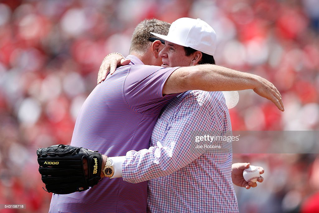 Former Cincinnati Reds great <a gi-track='captionPersonalityLinkClicked' href=/galleries/search?phrase=Pete+Rose&family=editorial&specificpeople=202020 ng-click='$event.stopPropagation()'>Pete Rose</a> gets a hug from his son Pete Jr. after a ceremonial first pitch following a ceremony to retire Rose's No. 14 prior to the game against the San Diego Padres at Great American Ball Park on June 26, 2016 in Cincinnati, Ohio.