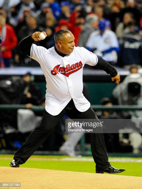 Former Cleveland Indians outfielder Carlos Baerga throws the ceremonial first pitch prior to Game 2 of the World Series on October 26 2016 between...