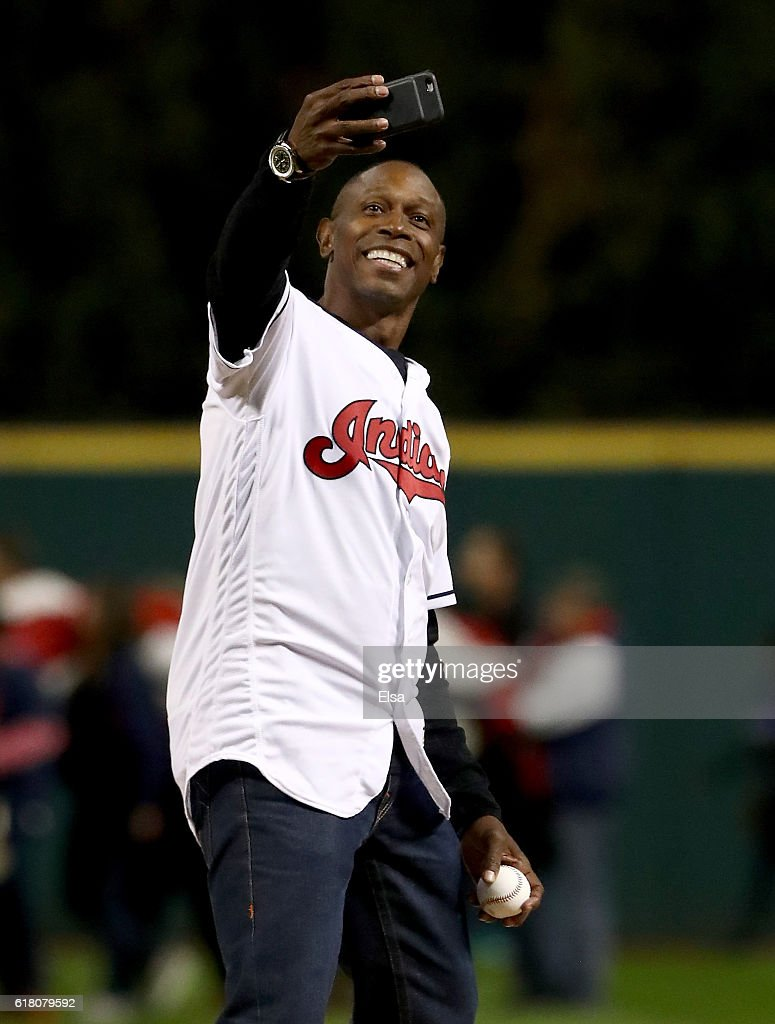 Former Cleveland Indians outfielder Kenny Lofton takes a selfie before throwing out the first pitch prior to Game One of the 2016 World Series against the Chicago Cubs at Progressive Field on October 25, 2016 in Cleveland, Ohio.