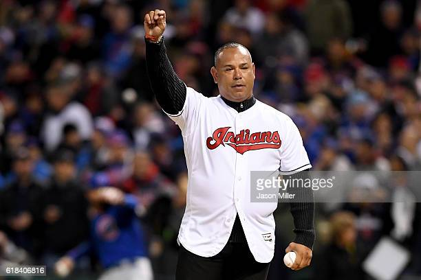 Former Cleveland Indians player Carlos Baerga gestures prior to throwing out the ceremonial first pitch before Game Two of the 2016 World Series...