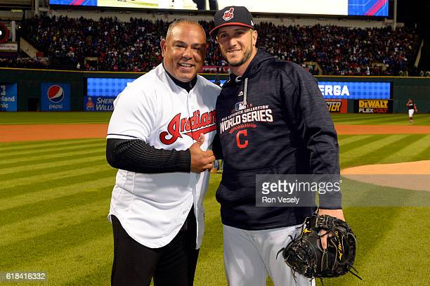 Former Cleveland Indians player Carlos Baerga poses for a photo with Yan Gomes of the Cleveland Indians after throwing out the ceremonial first pitch...