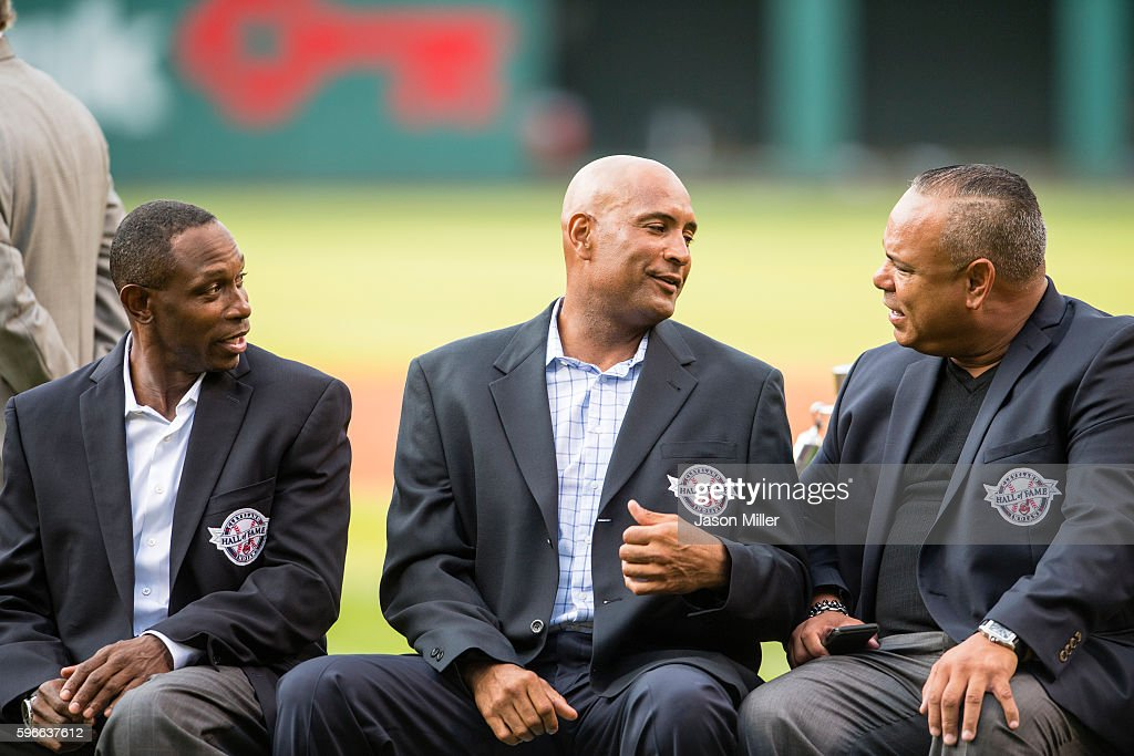 Former Cleveland Indians players Kenny Lofton, Sandy Alomar Jr and Carlos Baerga chat during the Hall of Fame induction ceremony prior to the game between the Cleveland Indians and the Oakland Athletics at Progressive Field on July 30, 2016 in Cleveland, Ohio.