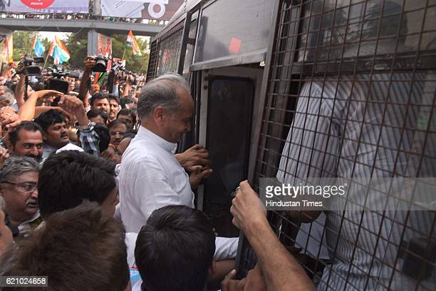 Former CM Ashok Gehlot along with congress supporters court arrest to protest detaining of Rahul Gandhi by Delhi cops over OROP issue at Bani park on...