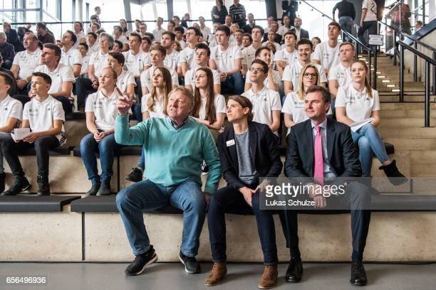 Former coach Horst Hrubesch soccer player Annike Krahn and Andre Carls of Commerzbank watch a presentation during the tribute to the DFB Junior...