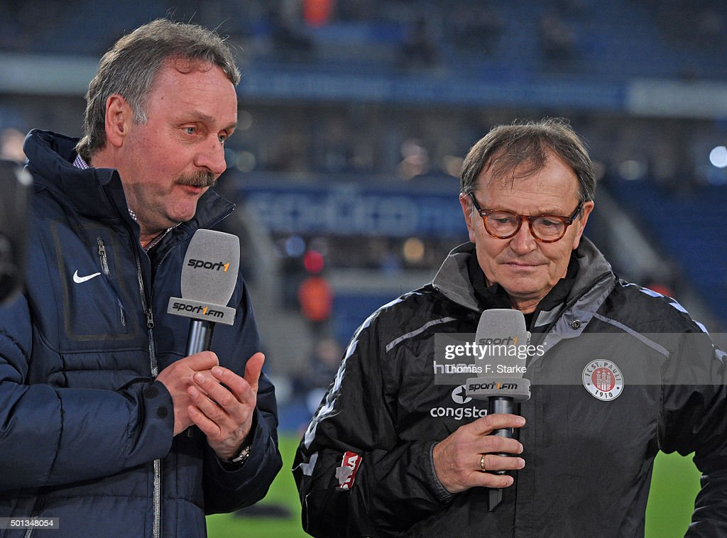 Former coach Peter Neururer talks to head coach Ewald Lienen of St Pauli prior to the Second Bundesliga match between Arminia Bielefeld and FC St...