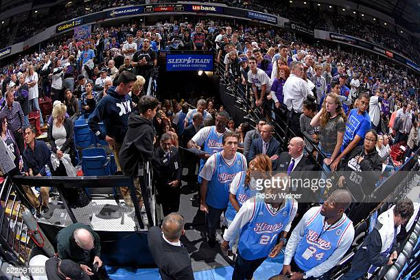 Former coach Vinny Del Negro Danielle Tisdale former NBA players Dennis Hopson and Anthony Bonner greet fans while exiting out of the tunnel after...