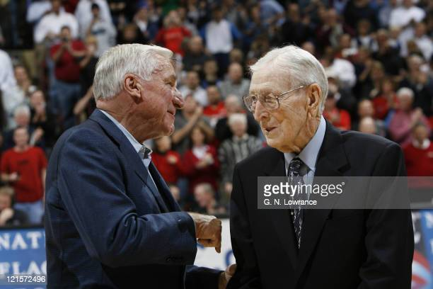 Former coaches Dean Smith and John Wooden during semifinal action between Air Force and Duke at the annual CBE Classic at Municipal Auditorium in...