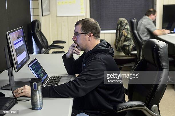 Former coal miner Jim Ratliff left works at a computer station at the Bit Source LLC office in Pikeville Kentucky US on Monday Feb 1 2016 Bit Source...