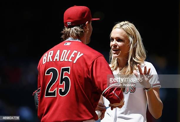 Former college softball AllAmerican from the University of Arizona and a Team USA Olympian Jennie Finch talks with Archie Bradley of the Arizona...