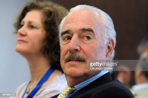 Former Colombian President Andres Pastrana head of the Carter Center listens to the speech of the opposition Partido Revolucionario Democratico...