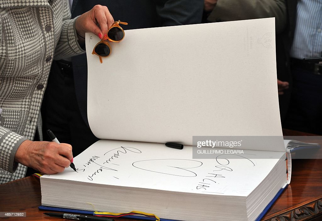Former Colombian presidential candidate Noemi Sanin signs a book during a ceremony to commemorate the 25th anniversary of the peace agreements between the government and the M-19 guerrilla, at the Simon Bolivar square in Bogota, on March 9, 2015.