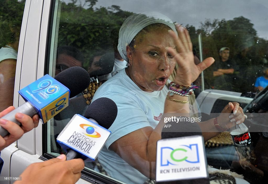 Former Colombian senator Piedad Cordoba gestures as she is bombarded with questions by journalists in the village La Cilia, Cauca department, Colombia, on February 14, 2013. The release of police officers Cristian Camilo Yate and Victor Alfonso Gonzalez, kidnapped by the Revolutionary Armed Forces of Colombia (FARC) guerrillas on January 25 in a rural area between the municipalities of Florida and Pradera, was postponed, according to Cordoba, due to the presence of journalists at the release site making it difficult for the operation to be carried out and hinted that the mission could be attempted again on Saturday. AFP PHOTO/LUIS ROBAYO