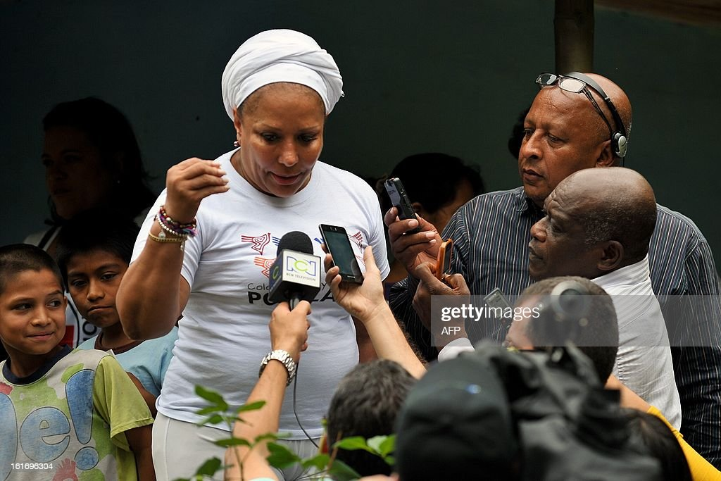 Former Colombian Senator Piedad Cordoba (L) speaks with journalists and members of local communities, on their way to where the release of kidnapped policemen will occur, on February 14, 2013, in the village Campo Alegre, Cauca department, Colombia. Cristian Camilo Yate and Victor Alfonso Gonzalez, two police officers who were kidnapped by the FARC on January 25 in a rural area between the municipalities of Florida and Pradera, will be delivered to delegates of the International Committee of the Red Cross (ICRC) and a commission of NGOs 'Colombianas y Colombianos por la Paz', headed by former Colombian Senator Piedad Cordoba. In addition this commission expects this Saturday, the soldier is released Josue Alvarez, kidnapped on January 30 in a mountainous area of the department of Narino. The FARC ahead a peace process with the government of President Juan Manuel Santos, in Havana, Cuba.