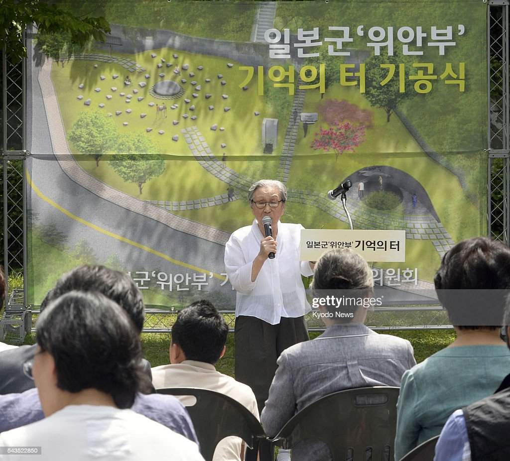 A former 'comfort woman' speaks during a groundbreaking ceremony in Seoul on June 29, 2016, to create a Site of Remembrance for those forced into the Japanese military's wartime brothels. Seoul Mayor Park Won Soon attended the ceremony.