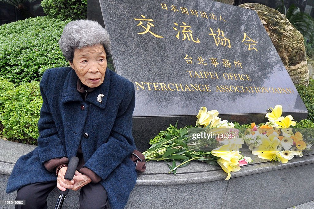 Former 'comfort woman' Taiwanese Tao Cheng-Chen sits during a commemoration for the deaths of former 'comfort women' during protests demanding Japan issue an official apology and justice, on International Human Rights Day in front of the building of the Interchange Association, Japan in Taipei on December 10, 2012. Former 'comfort women' from various countries have accused the Japanese government of inhumane crimes during World War II and are demanding an official apology and justice. AFP PHOTO / Mandy CHENG