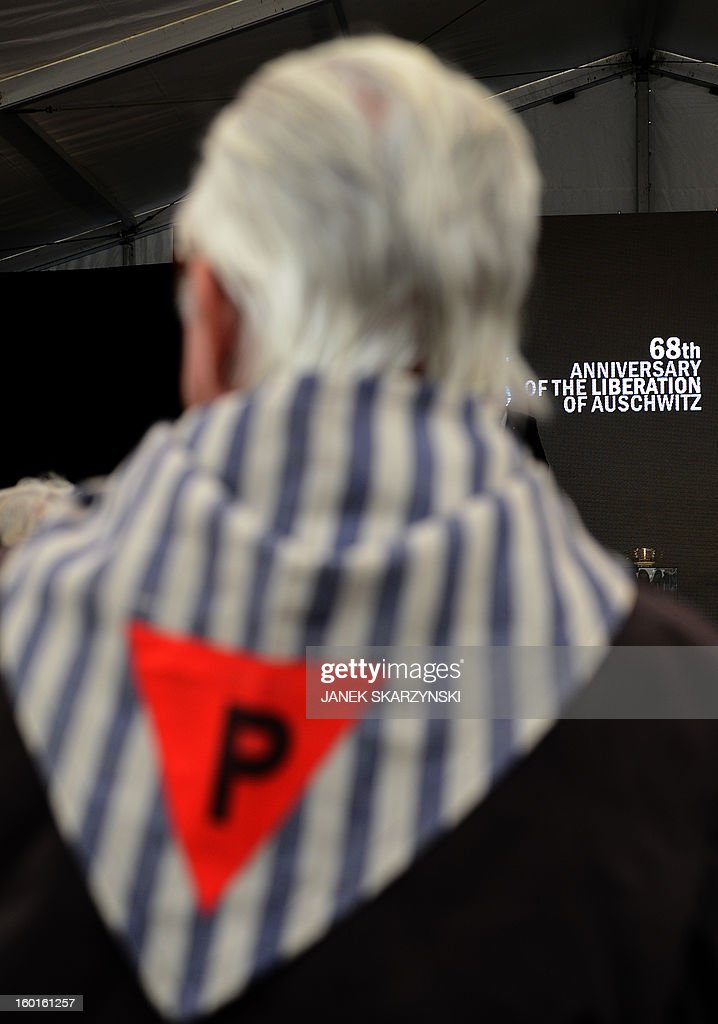 A former concentration camp prisoner attends a ceremony at the memorial site of the former Nazi concentration camp Auschwitz-Birkenau in Oswiecim, Poland, on Holocaust Day, January 27, 2013. The ceremony took place 68 years after the liberation of the death camp by Soviet troops, in rememberance of the victims of the Holocaust.