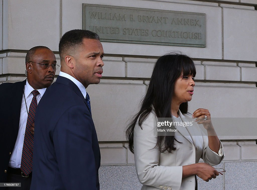 Former Congressman Jesse Jackson Jr. and his wife Sandi Jackson leave the federal court house after being sentenced to prison, August 14, 2013 in Washington, DC. Jackson was sentenced to 30 months in prison for using $750, 000 in campaign money to pay for living expenses and luxury items. His wife received a 12-month prison term.