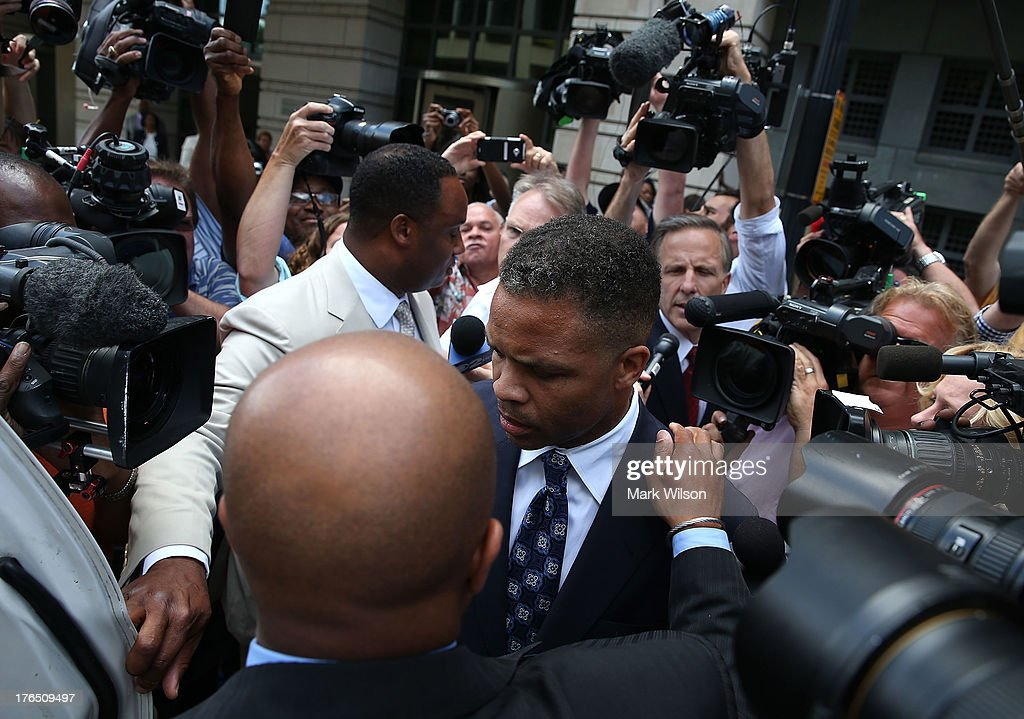 Former Congressman Jesse Jackson Jr. (D-IL) leaves the federal court house after being sentenced to prison, August 14, 2013 in Washington, DC. Jackson was sentenced to 30 months in prison for using $750,000 in campaign money to pay for living expenses and luxury items.
