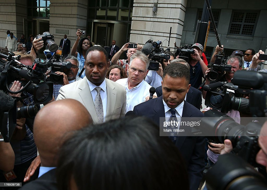 Former Congressman Jesse Jackson Jr. (R) leaves the federal court house after being sentenced to prison, August 14, 2013 in Washington, DC. Jackson was sentenced to 30 months in prison for using $750, 000 in campaign money to pay for living expenses and luxury items.
