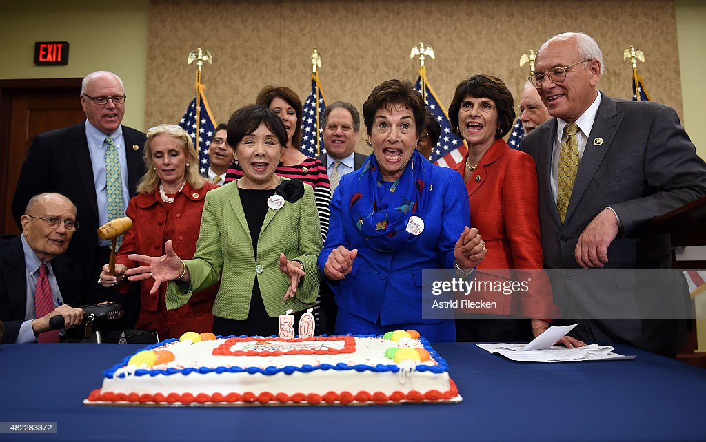 Former congressman <a gi-track='captionPersonalityLinkClicked' href=/galleries/search?phrase=John+Dingell&family=editorial&specificpeople=1358522 ng-click='$event.stopPropagation()'>John Dingell</a>, Rep. Joseph Crowley (D-NY), Rep. <a gi-track='captionPersonalityLinkClicked' href=/galleries/search?phrase=Debbie+Dingell&family=editorial&specificpeople=3528859 ng-click='$event.stopPropagation()'>Debbie Dingell</a> (D-MI), Rep. <a gi-track='captionPersonalityLinkClicked' href=/galleries/search?phrase=Doris+Matsui&family=editorial&specificpeople=2631068 ng-click='$event.stopPropagation()'>Doris Matsui</a> (D-CA), Rep. <a gi-track='captionPersonalityLinkClicked' href=/galleries/search?phrase=Jan+Schakowsky&family=editorial&specificpeople=584384 ng-click='$event.stopPropagation()'>Jan Schakowsky</a>(D-IL), Rep. Lucille Roybal-Allard (D-CA), Rep. Paul D. Tonko (D-NY) and other lawmakers celebrate the 50th anniversary of Medicare and Medicaid with a special cake on Capitol Hill on July 29, 2015 in Washington, DC. During the event they promised they would fight any proposed cuts to the important program for senior citizens.