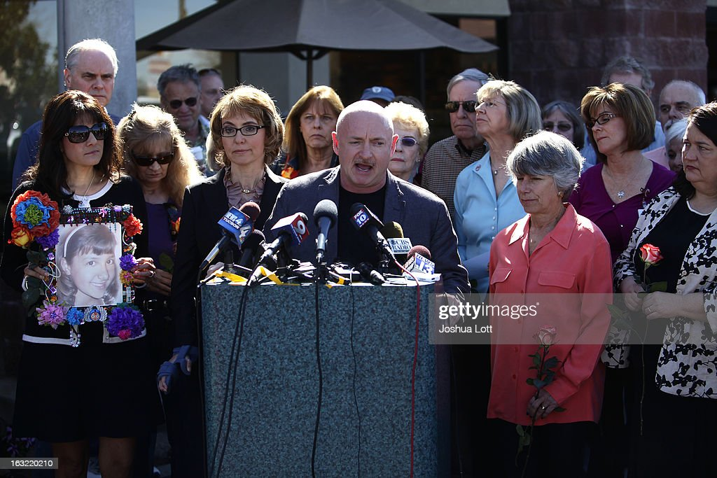 Former Congresswoman Gabby Giffords and her husband Mark Kelly are joined by survivors of the Tucson shooting as they call for Congress and the Senate to provide stricter gun control in the United States during a news conference on March 6, 2013 in Tucson, Arizona. Giffords and Kelly spoke outside the Safeway grocery store where the shooting happened two years ago where six people were killed.