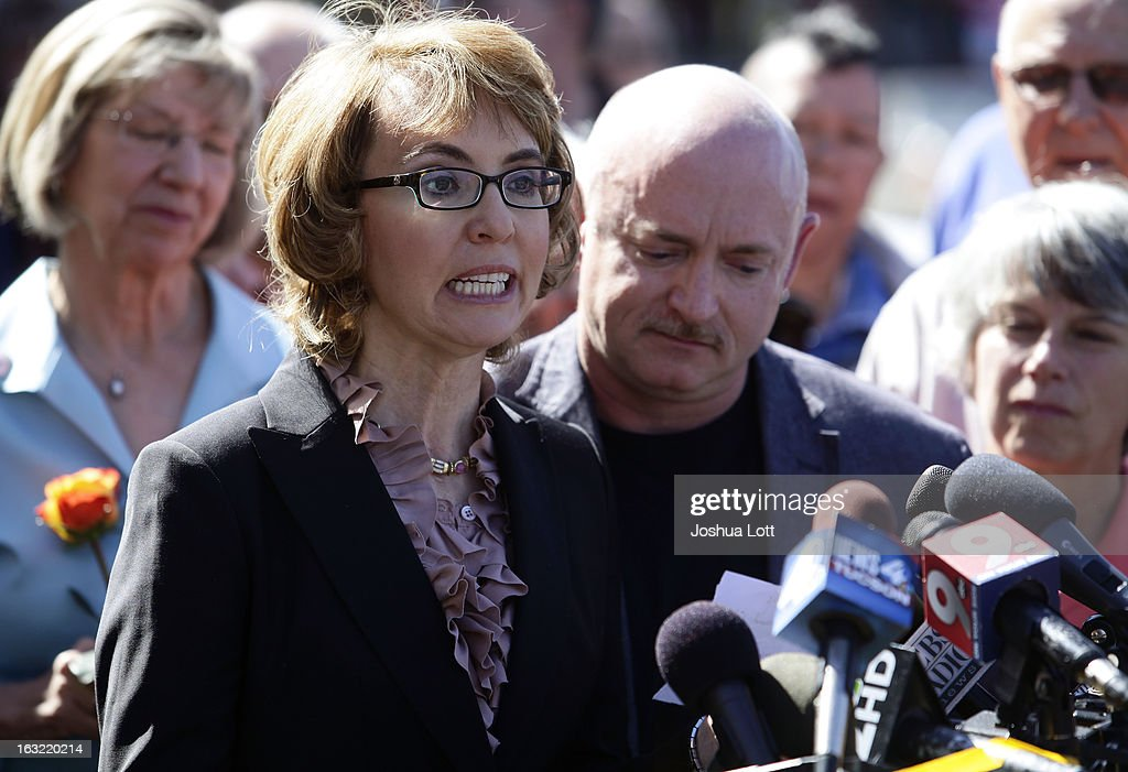 Former Congresswoman Gabby Giffords speaks with her husband Mark Kelly during a news conference as they call for Congress and the Senate to provide stricter gun control in the United States on March 6, 2013 in Tucson, Arizona. Giffords and Kelly spoke were joined by survivors of the Tucson shooting outside the Safeway grocery store where the shooting happened two years ago where six people were killed.