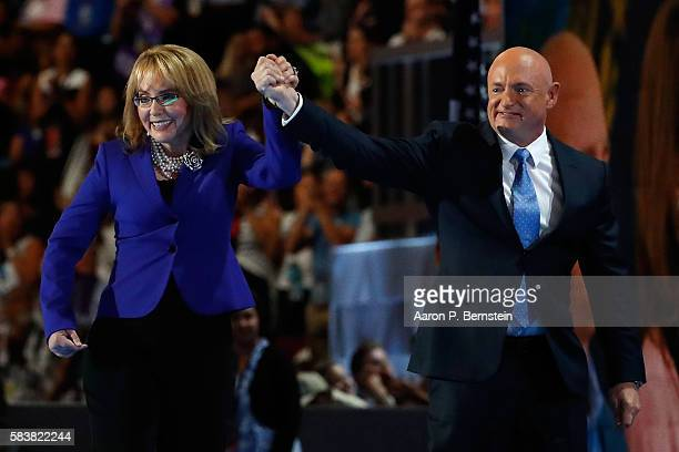 Former Congresswoman Gabby Giffords walks on stage with her husband retired NASA Astronaut and Navy Captain Mark Kelly after delivering remarks on...