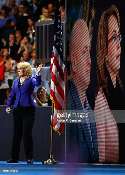 Former Congresswoman Gabby Giffords waves to the crowd as she arrives on stage to deliver remarks on the third day of the Democratic National...