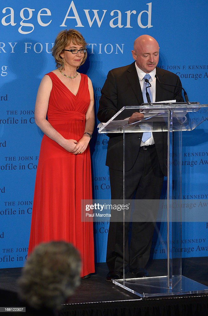 Former Congresswoman Gabrielle 'Gabby' Giffords receives the 2013 John F. Kennedy Profile In Courage Award with her husband astronaut Mark Kelly at The John F. Kennedy Presidential Library And Museum on May 5, 2013 in Boston, Massachusetts.