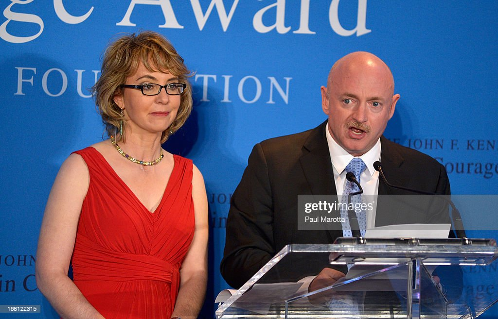Former Congresswoman Gabrielle 'Gabby' Giffords receives the 2013 John F. Kennedy Profile In Courage Award with her husband astronaut <a gi-track='captionPersonalityLinkClicked' href=/galleries/search?phrase=Mark+Kelly+-+Astronaut+and+Gun+Control+Advocate&family=editorial&specificpeople=566699 ng-click='$event.stopPropagation()'>Mark Kelly</a> at The John F. Kennedy Presidential Library And Museum on May 5, 2013 in Boston, Massachusetts.