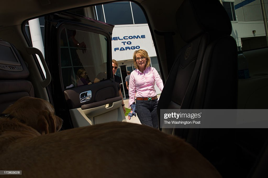 Former Congresswoman Gabrielle Giffords arrives in Fargo during the Americans for Responsible Solutions tour in North Dakota, on Wednesday, July 3, 2013.