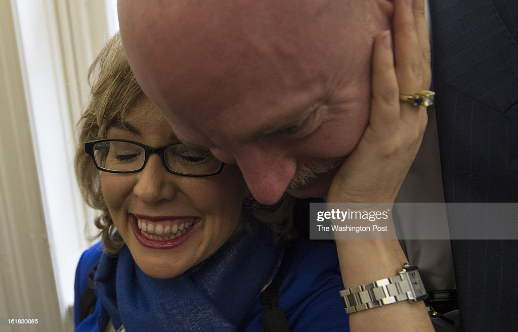 Former Congresswoman Gabrielle Giffords caresses her husband Mark Kelly's face as they made the rounds to talk about the issue of gun violence on Capitol Hill in Washington, D.C., on Wednesday, February 13, 2013. Great tragedies drive married couples together or they drive them apart. January 8, 2011 brought Giffords and Kelly closer than ever. He often puts his arm around her. She gazes at him adoringly.