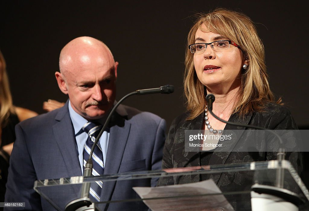 Former Congresswoman <a gi-track='captionPersonalityLinkClicked' href=/galleries/search?phrase=Gabrielle+Giffords&family=editorial&specificpeople=6961081 ng-click='$event.stopPropagation()'>Gabrielle Giffords</a> (R), joined by husband Captain <a gi-track='captionPersonalityLinkClicked' href=/galleries/search?phrase=Mark+Kelly+-+Astronaut+en+tegenstander+openbaar+wapenbezit&family=editorial&specificpeople=566699 ng-click='$event.stopPropagation()'>Mark Kelly</a>, speaks at the 'Not One More' Event at Urban Zen on February 10, 2015 in New York City.