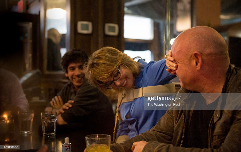 Former Congresswoman Gabrielle Giffords playfully covers her husband Mark Kelly's eyes during dinner at Peacock Alley in Bismarck, North Dakota, on Tuesday, July 2, 2013. The couple have embarked on the Americans for Responsible Solutions tour to 7 states across America which started in Nevada, before moving onto Alaska and North Dakota.