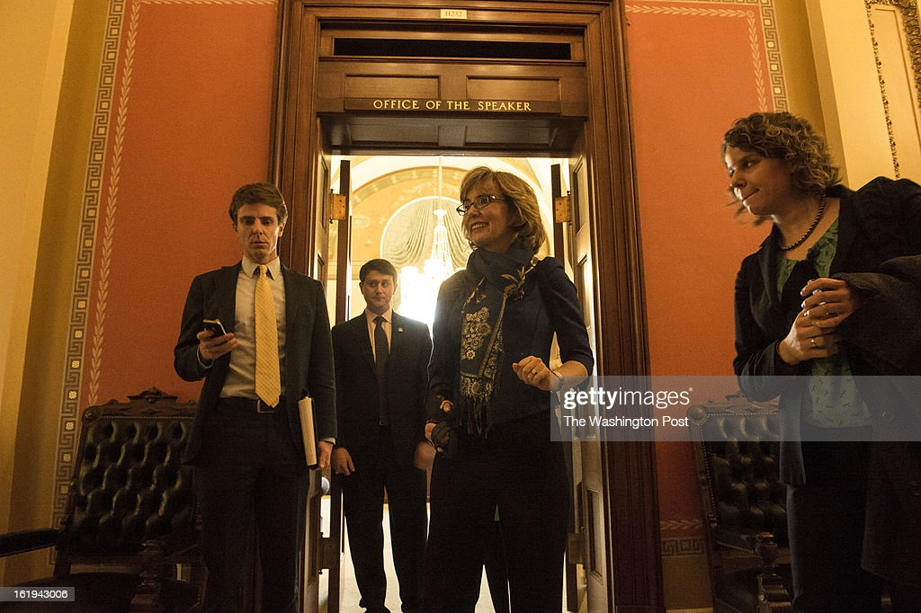 Former Congresswoman Gabrielle Giffords smiles as she leaves Speaker of the House John Boehner's office following a meeting on Capitol Hill in Washington, D.C., on Wednesday, February 13, 2013. From left is Giffords staff member Peter Ambler, Tyler Pumphrey, with the office of accessibility under the Sergeant of Arms and staff member, Pia Carousone.