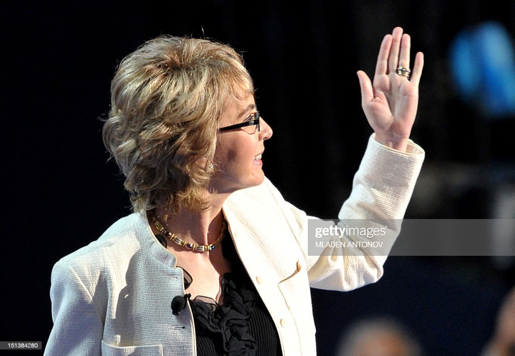 Former congresswoman Gabrielle Giffords waves to the audience at the Time Warner Cable Arena in Charlotte, North Carolina, on September 6, 2012 on the final day of the Democratic National Convention (DNC). US President Barack Obama is expected to accept the nomination from the DNC to run for a second term as president. AFP PHOTO Mladen ANTONOV