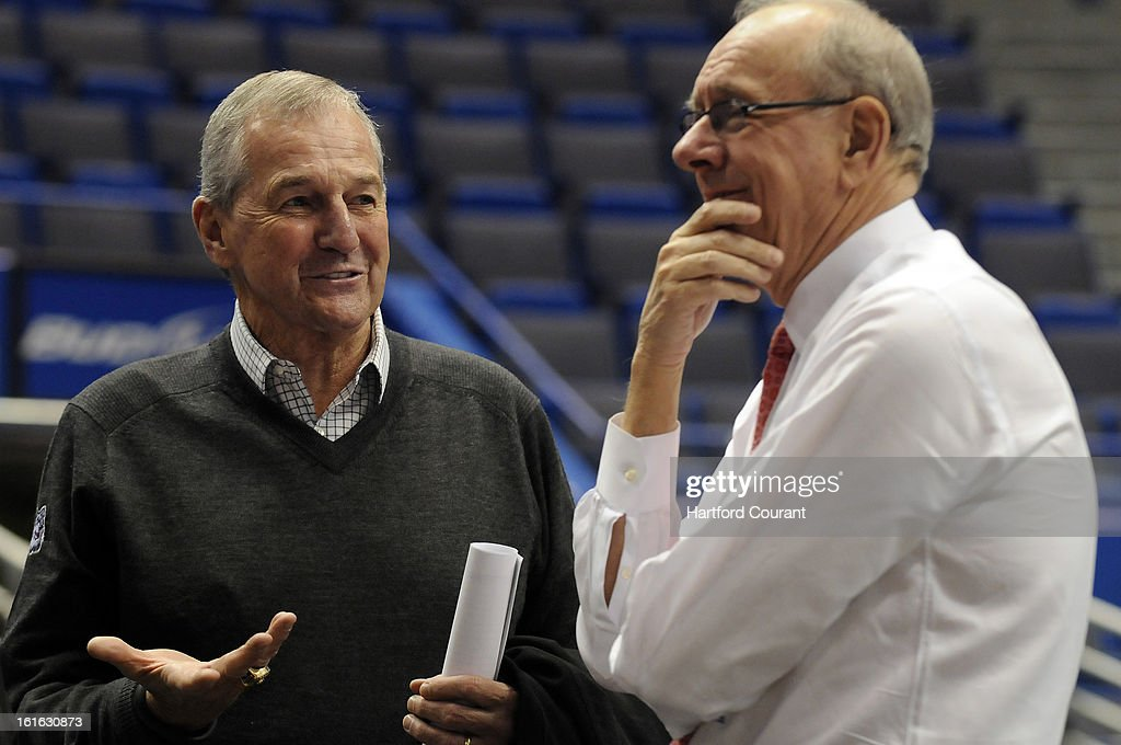 Former Connecticut head coach Jim Calhoun, left, and Syracuse head coach Jim Boeheim chat before the two teams meet for the final time during the regular season as members of the Big East on Wednesday, February 13, 2013, at the XL Center in Hartford, Connecticut.