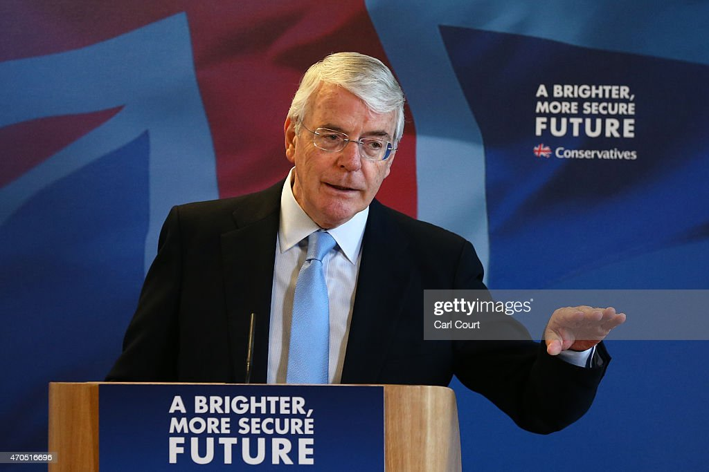 Former Conservative British Prime Minister John Major gestures during a speech on April 21 2015 in Solihull England Major joined the election...