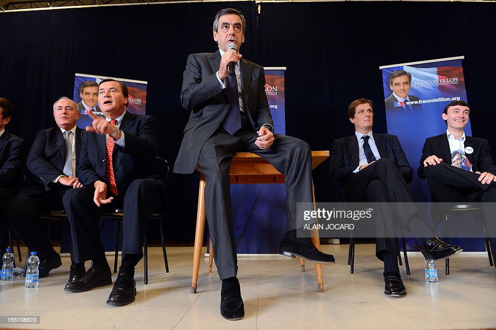 Former conservative prime minister François Fillon (foreground), flanked by Nice UMP Mayor Christian Estrosi (2ndR) delivers a speech on November 07, 2012 in La Chaussée-Saint-Victor near Blois, as part of his campaign for the UMP right wing party presidency -