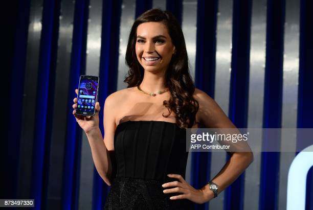 Former contestant of 'MasterChef Australia' Sarah Todd holds the newly launched Lenovoowned Motorola Moto X4 smartphone at a promotional event in New...