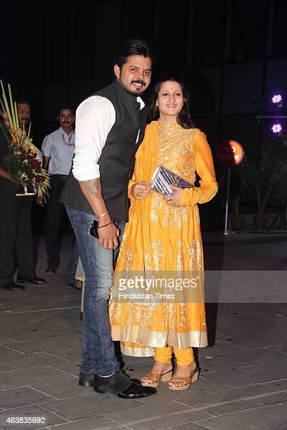 Former cricket player S Sreesanth with wife Bhuvneshwari Kumari during the wedding reception of Bollywood filmmaker Smita Thackeray's son Rahul...