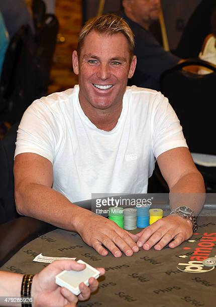 Former cricket player Shane Warne participates in the TJ Martell Foundation's second annual Chad Brown Memorial Poker Tournament at Planet Hollywood...